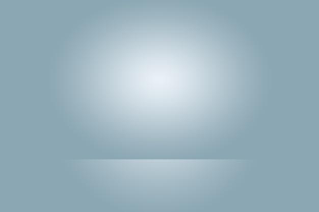 Abstrakte studiohintergrundbeschaffenheit der hellblauen und grauen steigungswand, flacher boden. für produkt.