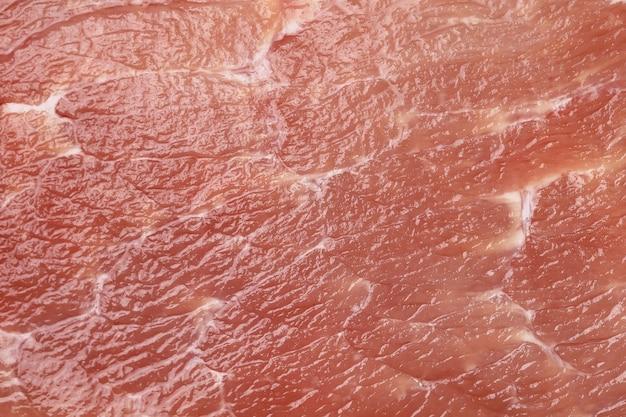 Abstrakte textur hintergrund rotes schweinefleisch mit streifen