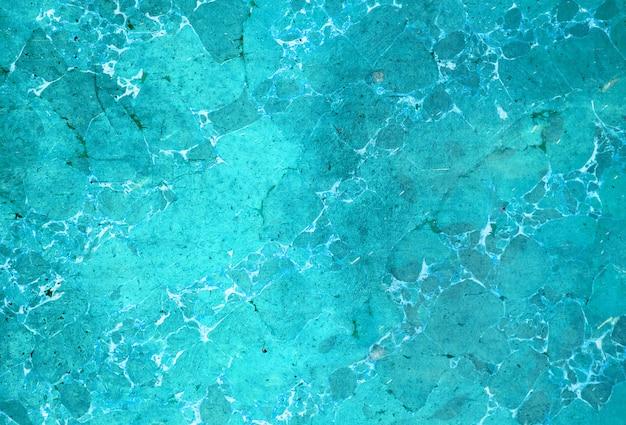 Abstrakte türkisfarbene marmorierte oberfläche