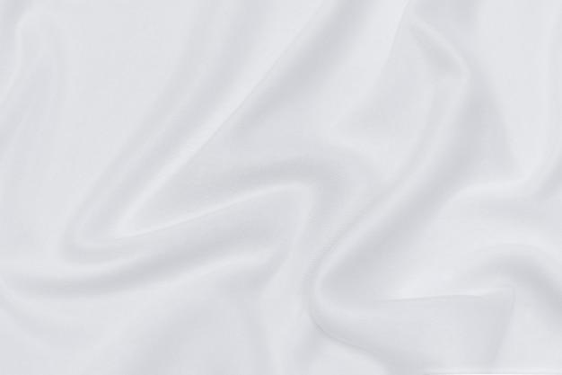 Abstrakte und weiche fokuswelle aus weißem oder elfenbeinfarbenem stoffhintergrund, weißer textur und details