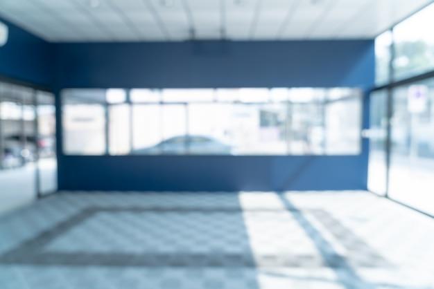 Abstrakte unschärfe leeres büro mit glasfenster und sonnenlicht