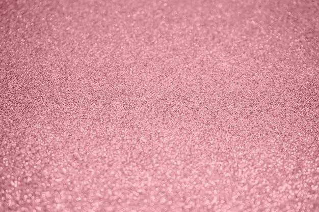 Abstrakte unschärfe roségold glitzer funkeln defokussiert bokeh licht hintergrund