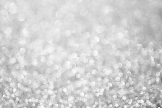 Abstrakte unschärfe silberglitter funkeln defokussiertes bokeh-licht