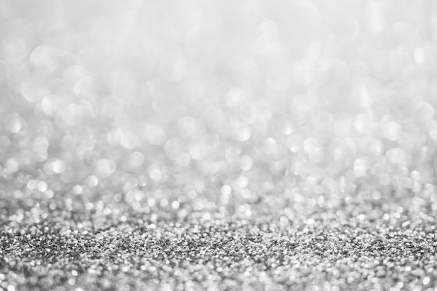 Abstrakte unschärfe silberner glitzerschein defokussierter bokeh-lichthintergrund