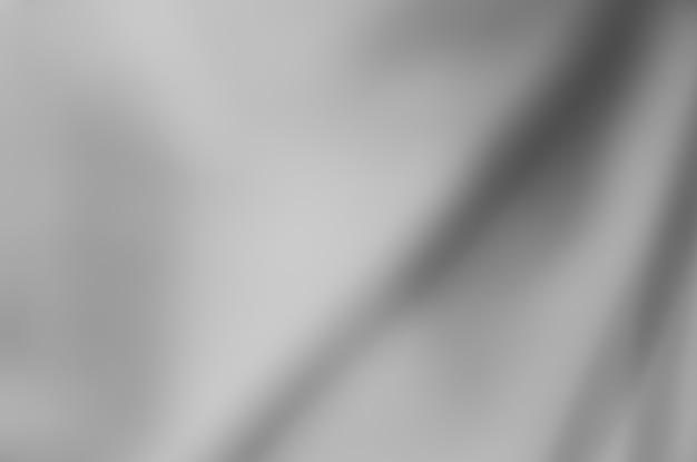 Abstrakte unschärfe stoff schwarz-weiß-textur hintergrund