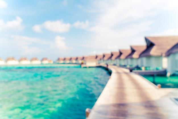 Abstrakte unschärfe tropischen malediven resort hotel und insel mit strand und meer für hintergrund