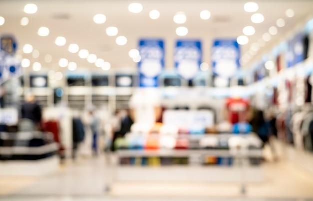 Abstrakte unschärfe und defocused bekleidungsgeschäft am einkaufszentrum des kaufhauses für hintergrund