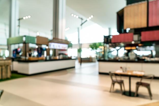 Abstrakte unschärfe und defokussiert food court center im einkaufszentrum
