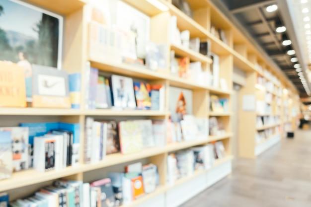 Abstrakte unschärfe und defokussierte bibliothek und buchladen shop innenraum