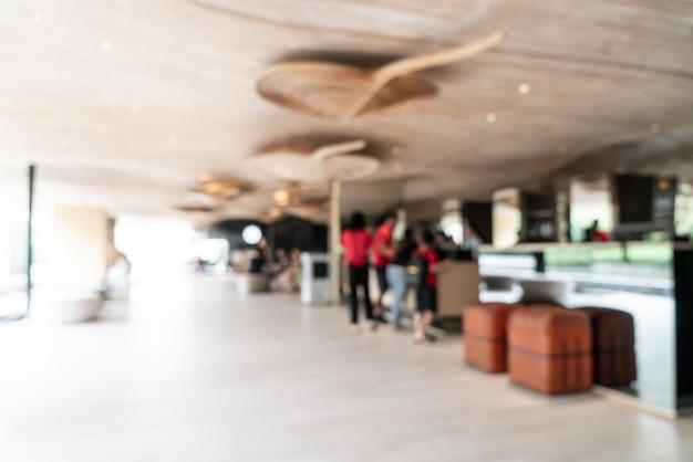 Abstrakte unschärfe und defokussierte lobby im hotelresort als unscharfer hintergrund