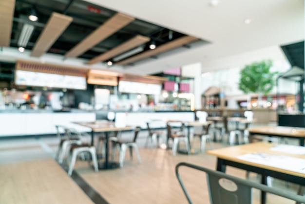 Abstrakte unschärfe und defokussiertes food court center im einkaufszentrum