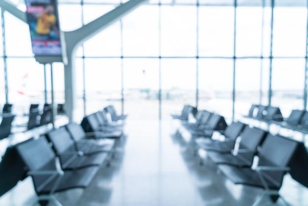 Abstrakte unschärfe und defokussiertes interieur des flughafenterminals