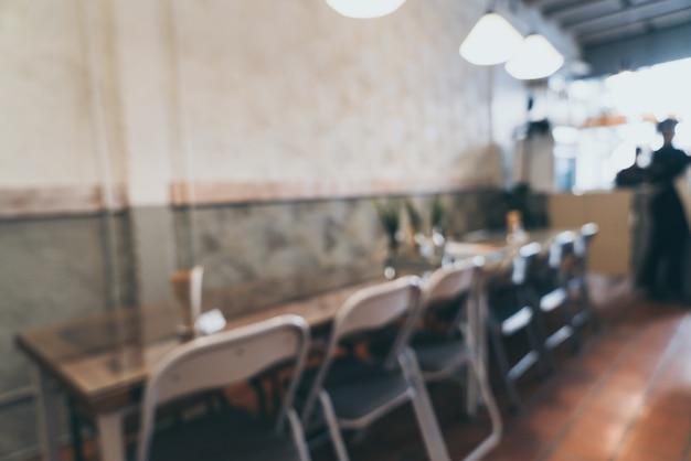 Abstrakte unschärfe und unschärfe in der kaffeestube und im café für hintergrund
