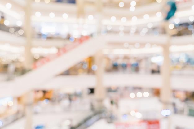Abstrakte unschärfehintergrund-mengenleute im einkaufszentrum für hintergrund, weinlese getont.