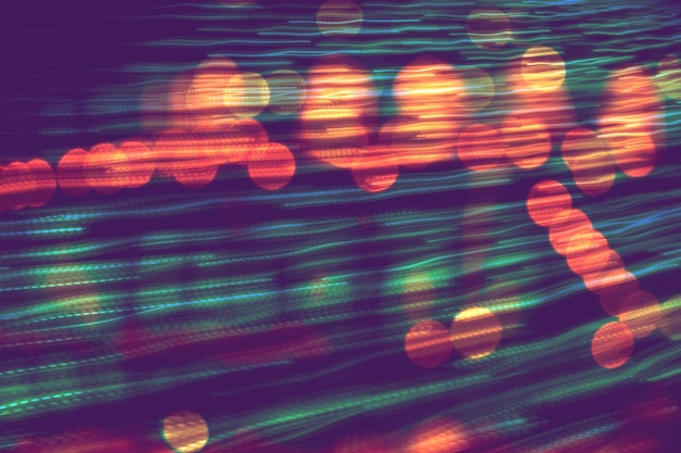 Abstrakte unscharfe geschwindigkeitsbewegung in richtung des hellen, mehrfarbigen hellen hintergrunds mit defokussiertem bokeh-licht, hintergrund des party-unschärfe-feierkonzepts.