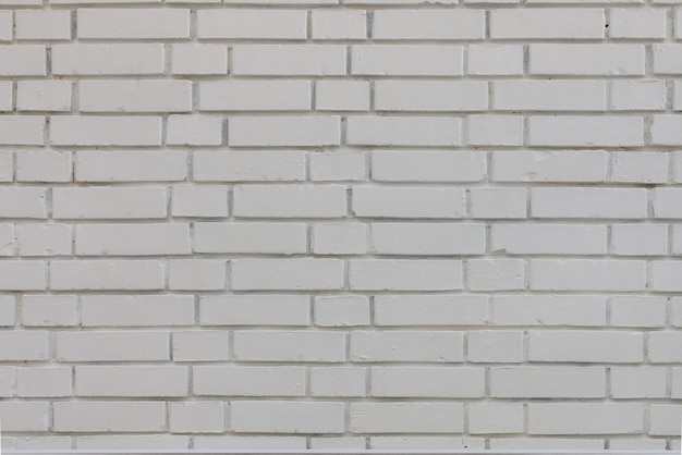 Abstrakte verwitterte textur befleckte alten stuck hellgrau und gealterter weißer backsteinmauerhintergrund im ländlichen raum, grungy rostige blöcke der mauerwerkstechnologie farbe horizontale architekturtapete