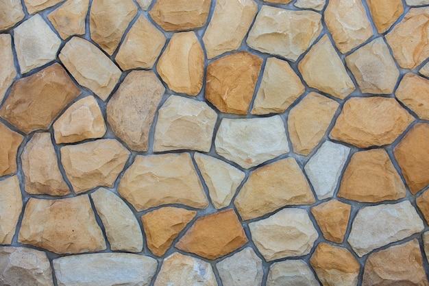 Abstrakte wandfläche aus sandsteinen zur verwendung als hintergrund.