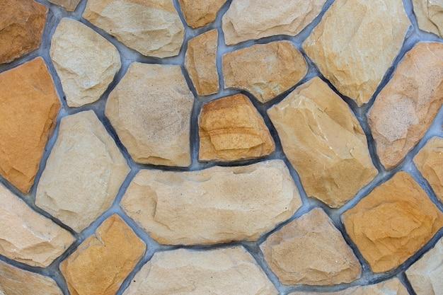 Abstrakte wandoberfläche aus sandsteinen für den einsatz als.