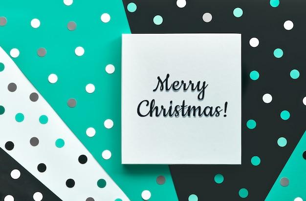Abstrakte weihnachtsfahne oder kartenschablone mit konfetti, tupfen.
