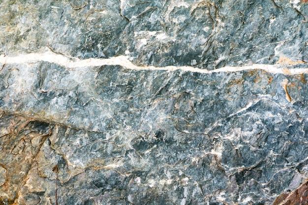 Abstrakter alter granitsteinmable-blattoberflächen-höhleninnenraumhintergrund