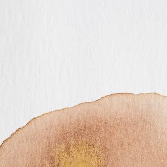 Abstrakter aquarellhintergrund mit einem braunen splatter der aquarellfarbe