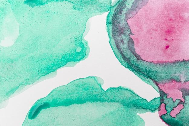 Abstrakter aquarellrosa und grüner hintergrund