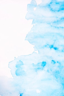 Abstrakter blauer fleckaquarellhintergrund