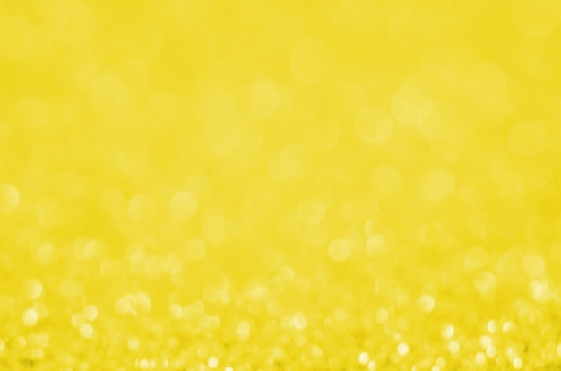 Abstrakter bokeh-hintergrund, der pantone-farbe des jahres 2021 beleuchtet