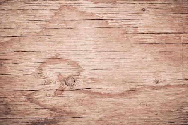 Abstrakter brauner hölzerner hintergrund, gestreifter bauholzschreibtisch der planke, draufsicht der braunen hölzernen tabelle