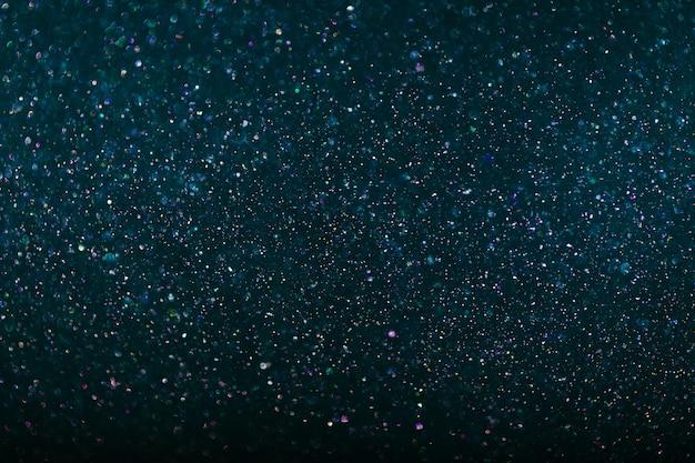 Abstrakter dunkelblauer bokeh kreist hintergrund ein, glitzerlicht defokussiert