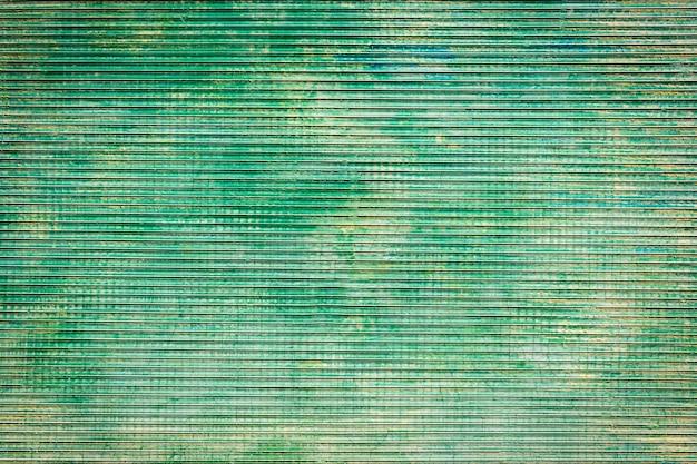 Abstrakter dunkelgrüner verwitterter metalltexturhintergrund
