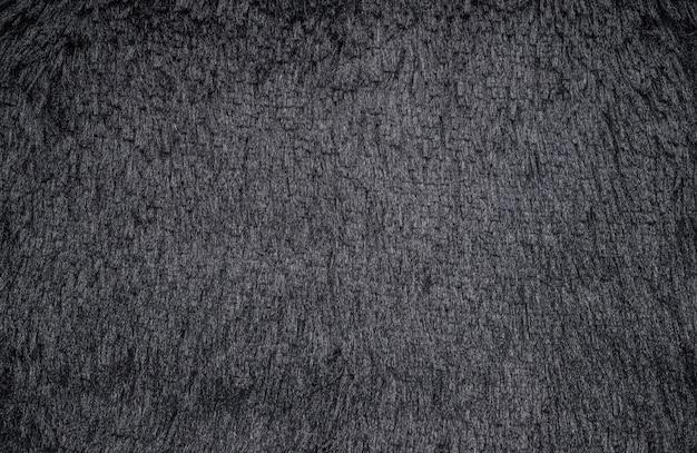 Abstrakter dunkler pelzteppichbeschaffenheitshintergrund