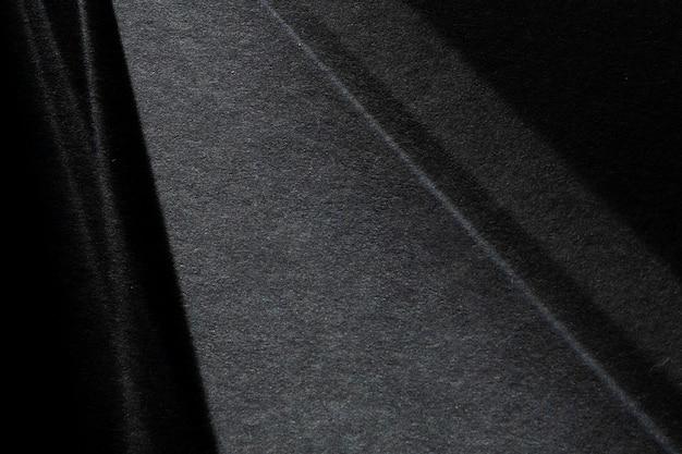 Abstrakter dunkler ton strukturiert