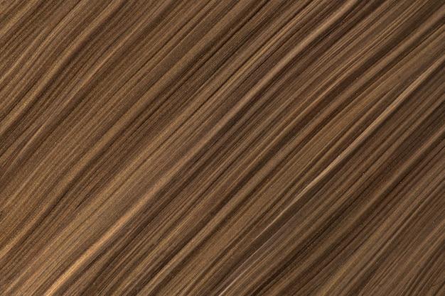Abstrakter flüssiger kunsthintergrund dunkelbraun und bronzefarben. flüssiger marmor. acrylmalerei auf leinwand mit umbra-gefälle. aquarellhintergrund mit gestreiftem muster. marmortapete aus stein.