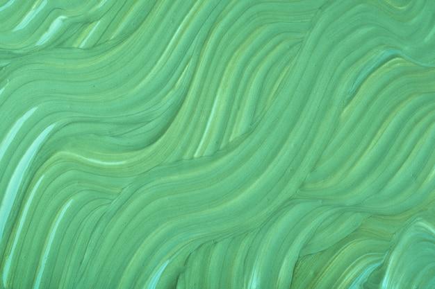 Abstrakter flüssiger kunsthintergrund grüne farben acrylmalerei mit olivgrünem farbverlauf mit wellenmuster