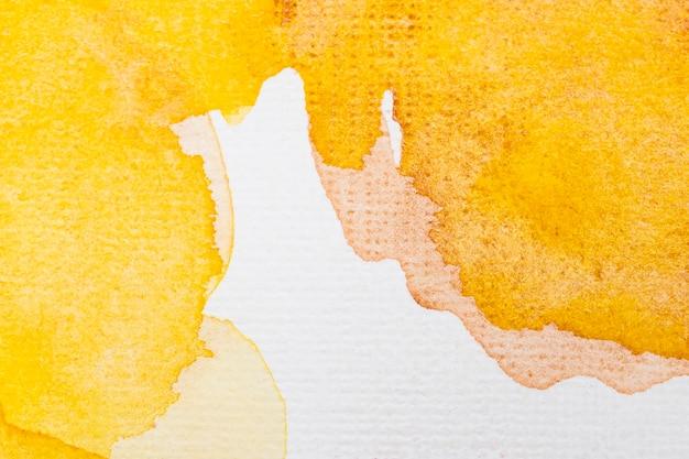 Abstrakter gelber kopienraummusterhintergrund