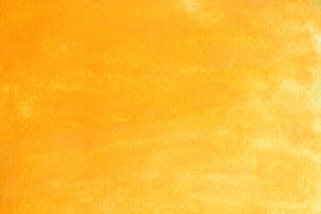 Abstrakter gelber oder goldaquarellhintergrund. kunst handfarbe