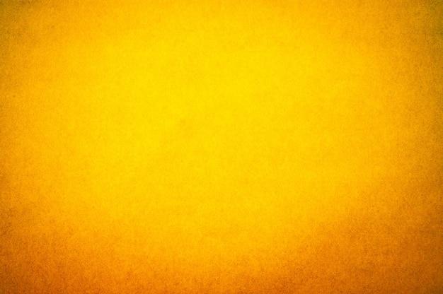 Abstrakter gelber papierbeschaffenheitshintergrund der weinlese