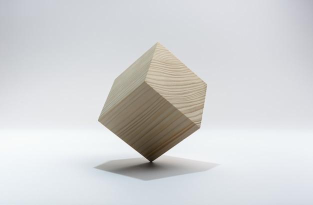Abstrakter geometrischer realer hölzerner würfel auf weißem hintergrund