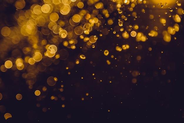 Abstrakter goldener bokeh luxusgebrauch für hintergrund