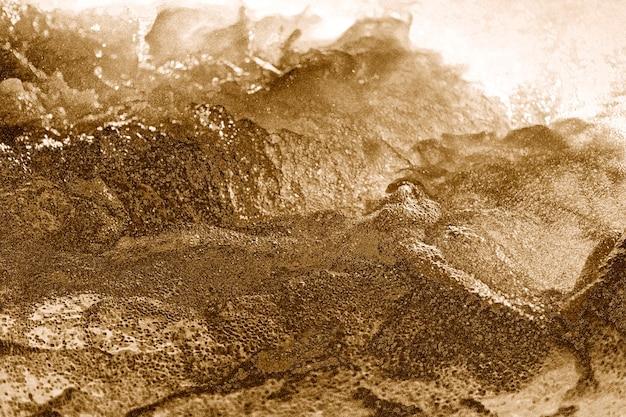 Abstrakter goldener holpriger strukturierter hintergrund