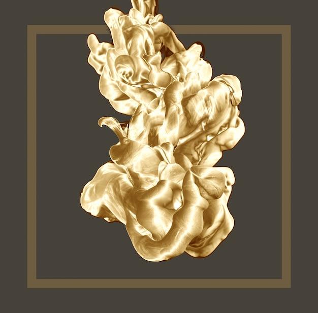 Abstrakter goldener tintentropfen auf klarem hintergrund mit rahmen.