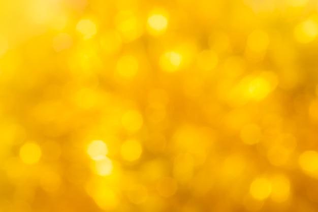 Abstrakter goldgelber bokeh-hintergrund für ihr design