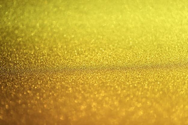 Abstrakter goldglister bokeh hintergrund