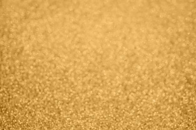 Abstrakter goldglitter-scheinhintergrund