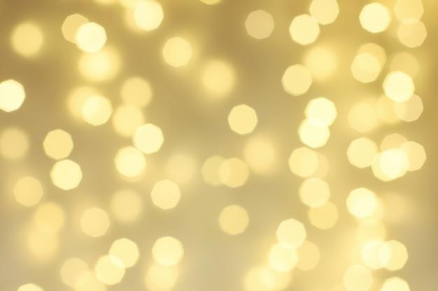 Abstrakter goldschimmerhintergrund, defokussiertes weihnachtsbokeh.
