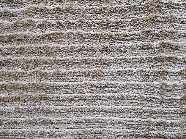 Abstrakter grauer teppich beschaffenheits-hintergrundabschluß oben