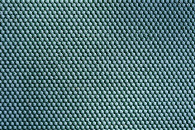 Abstrakter grüner metallhintergrund. eisen punktiert textur auf metallwand im freien.