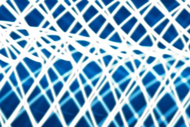 Abstrakter heller hintergrund. blaue verschwommene lichter, streifen und bokeh