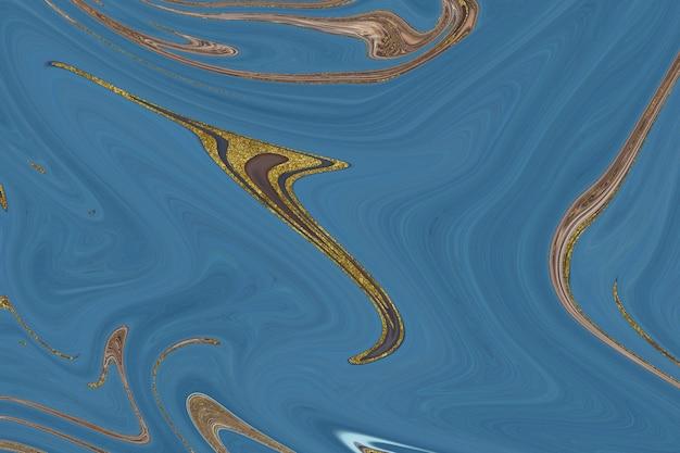 Abstrakter hintergrund aus blauem und goldenem marmor